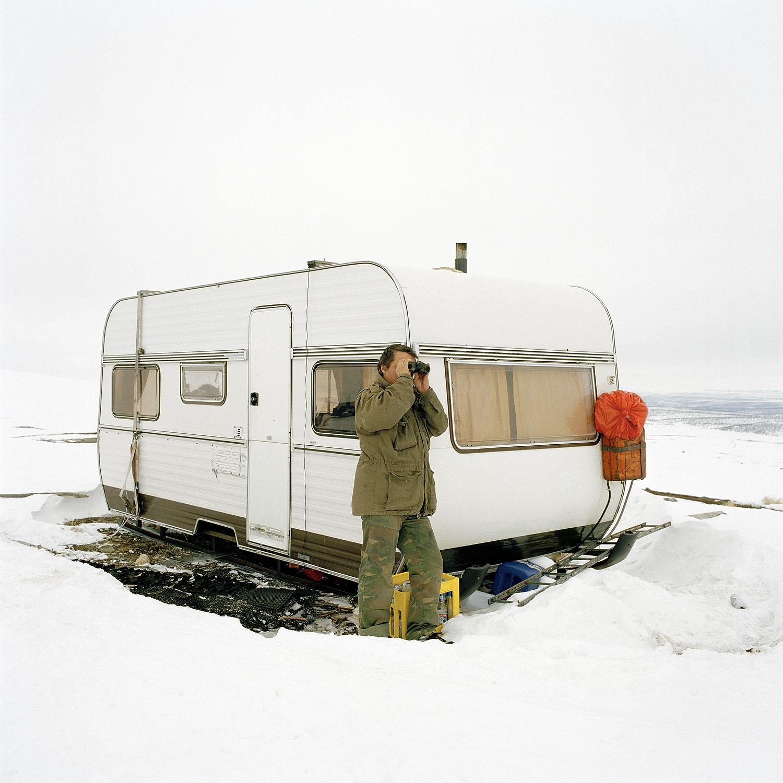 Simon Ailo watching his herd, 2005