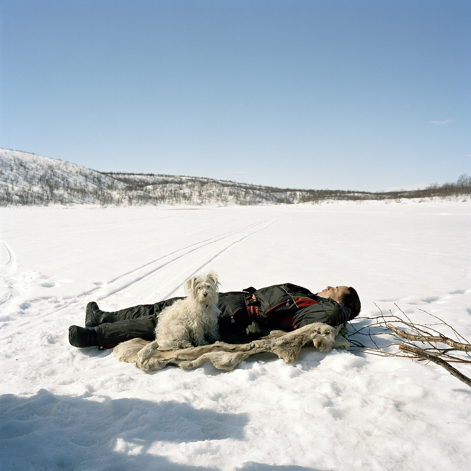 Ole Ailo sleeping on reindeer skin, 2005